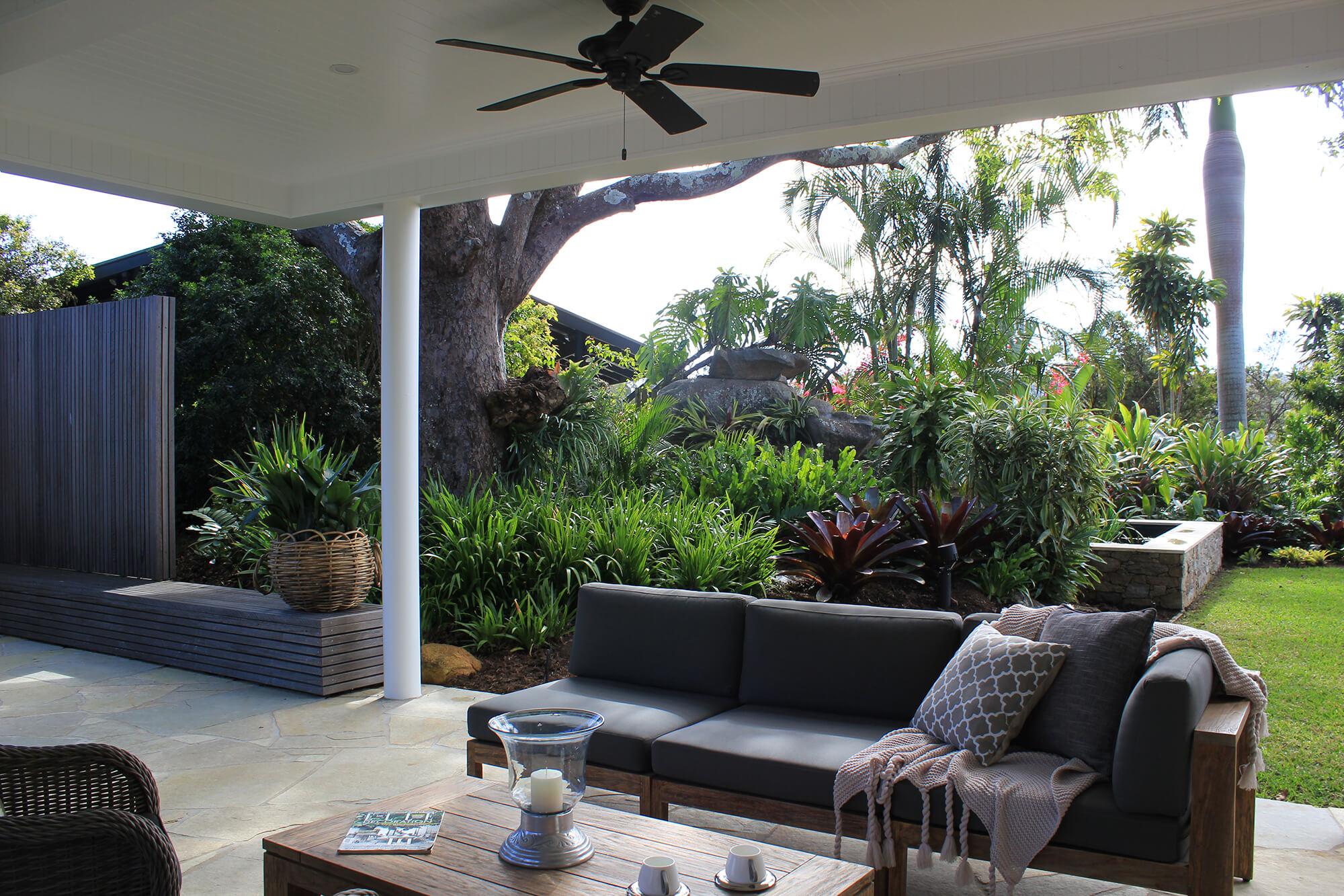 the gap outdoor entertaining area sofa bench seating and tropical garden
