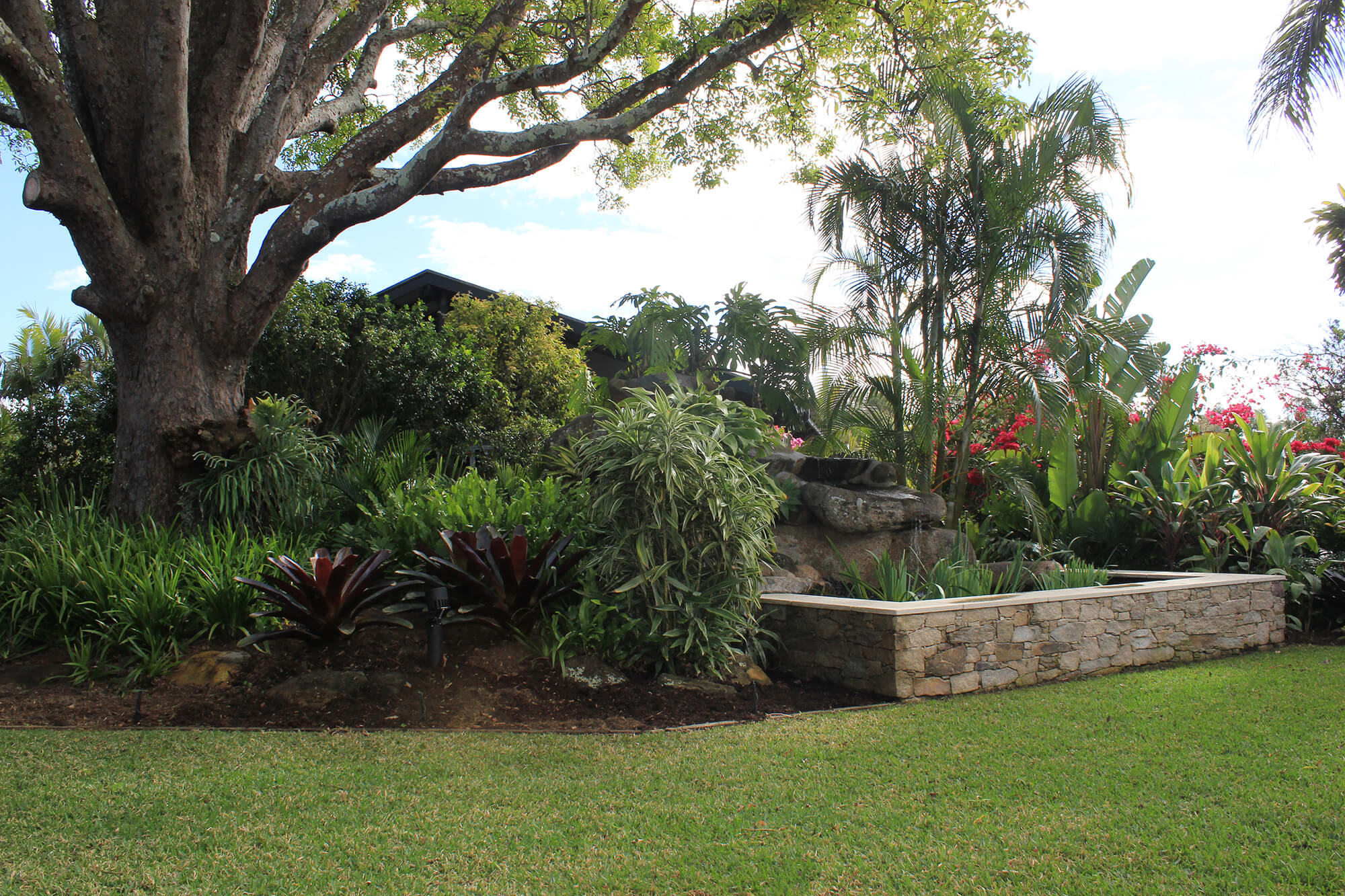 the gap landscaping with alpine stone water feature and limestone capping