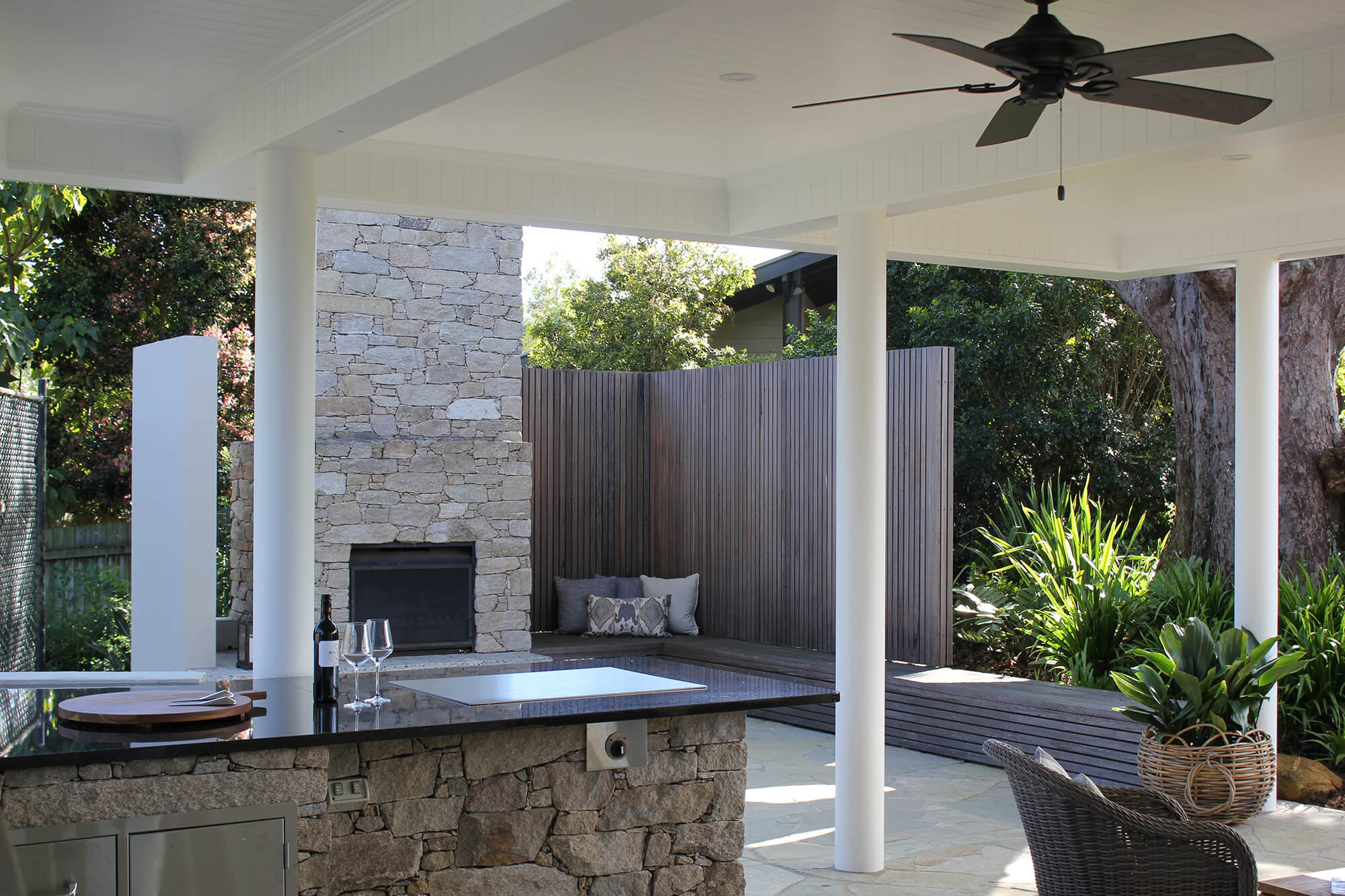 the gap custom made alpine stone clad teppinyaki plate with fireplace and timber screening