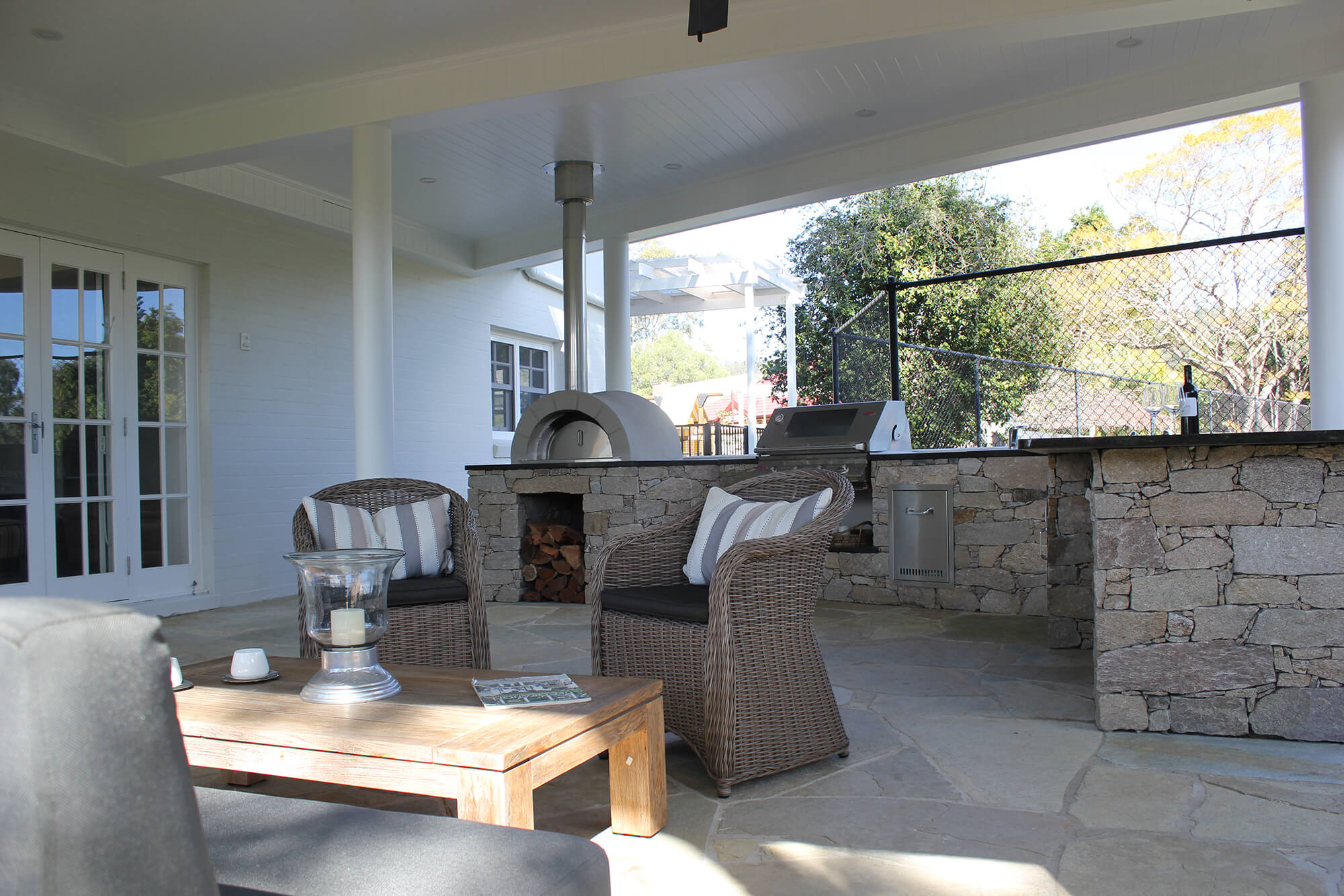 the gap custom outdoor kitchen with inbuilt bbq and pizza oven