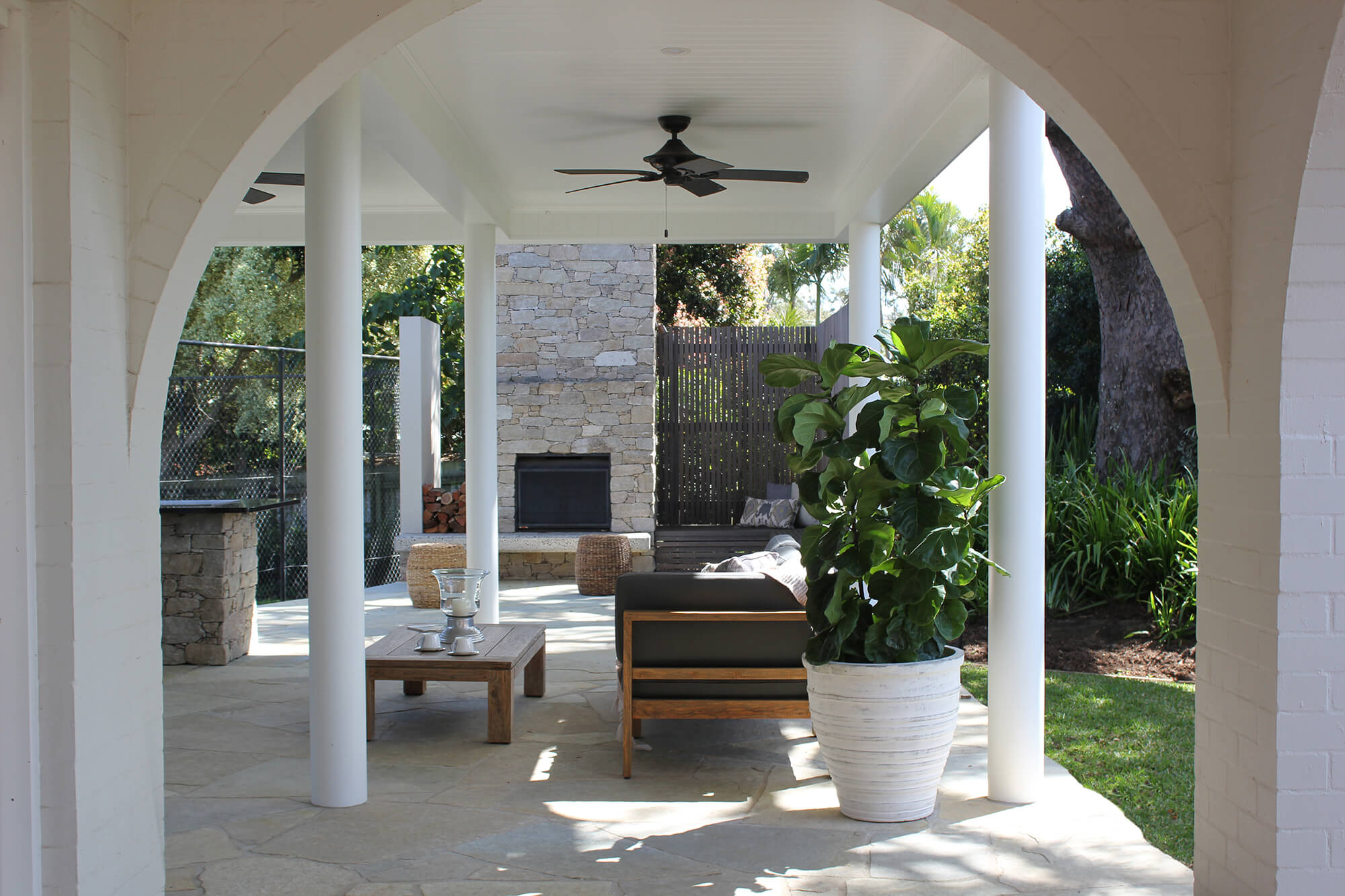the gap outdoor entertaining area with arch and columns