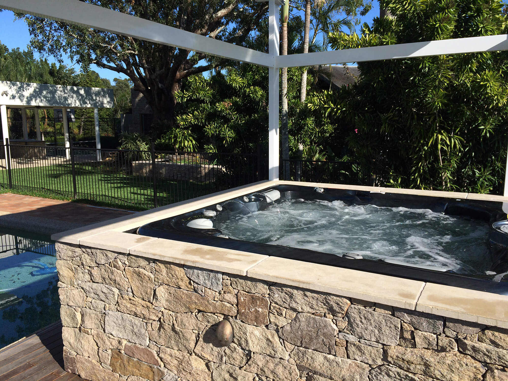 redcliffe custom made alpine stone spa enclosure and gazebo