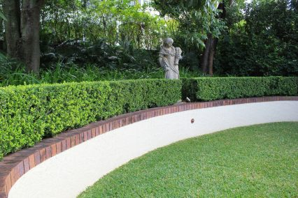 clayfield formal garden hedge with lighting