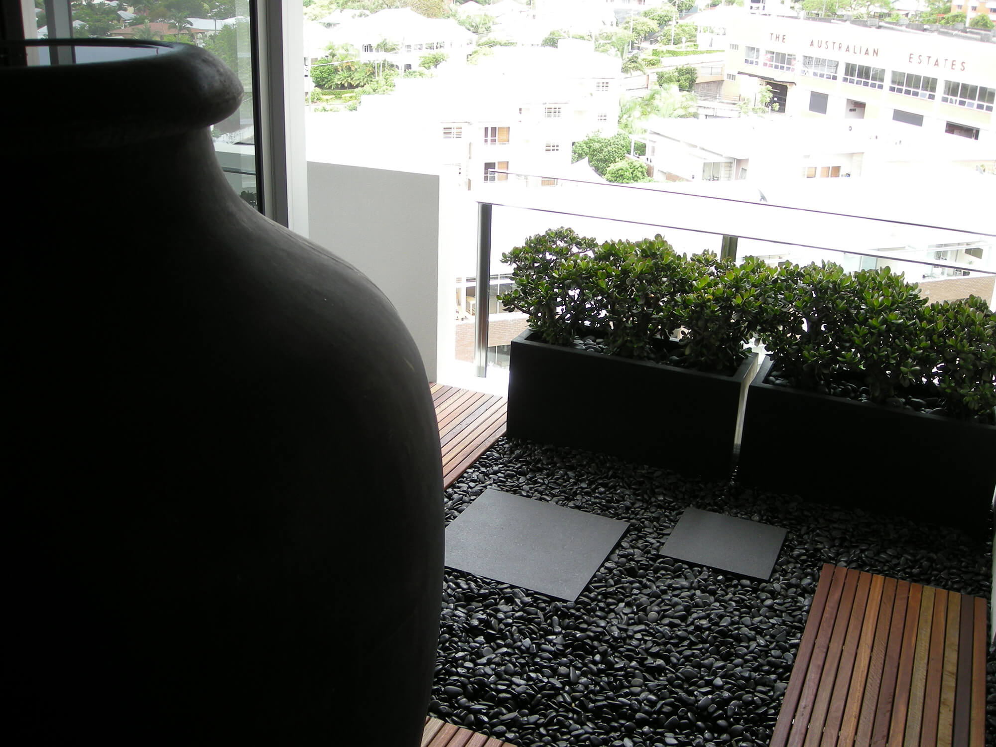 new farm apartment potted succulents with decorative black stone