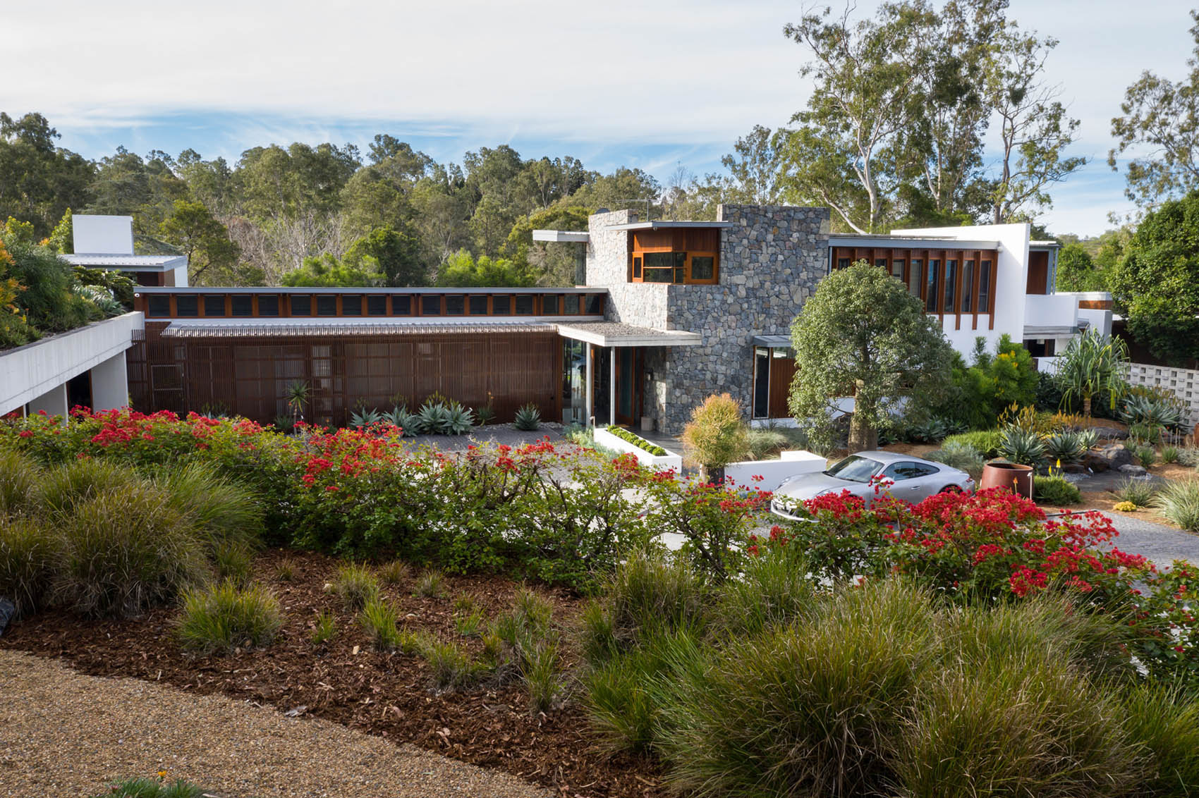Layers of planting enhance the architectural lines of this contemporary residence at Brookfield